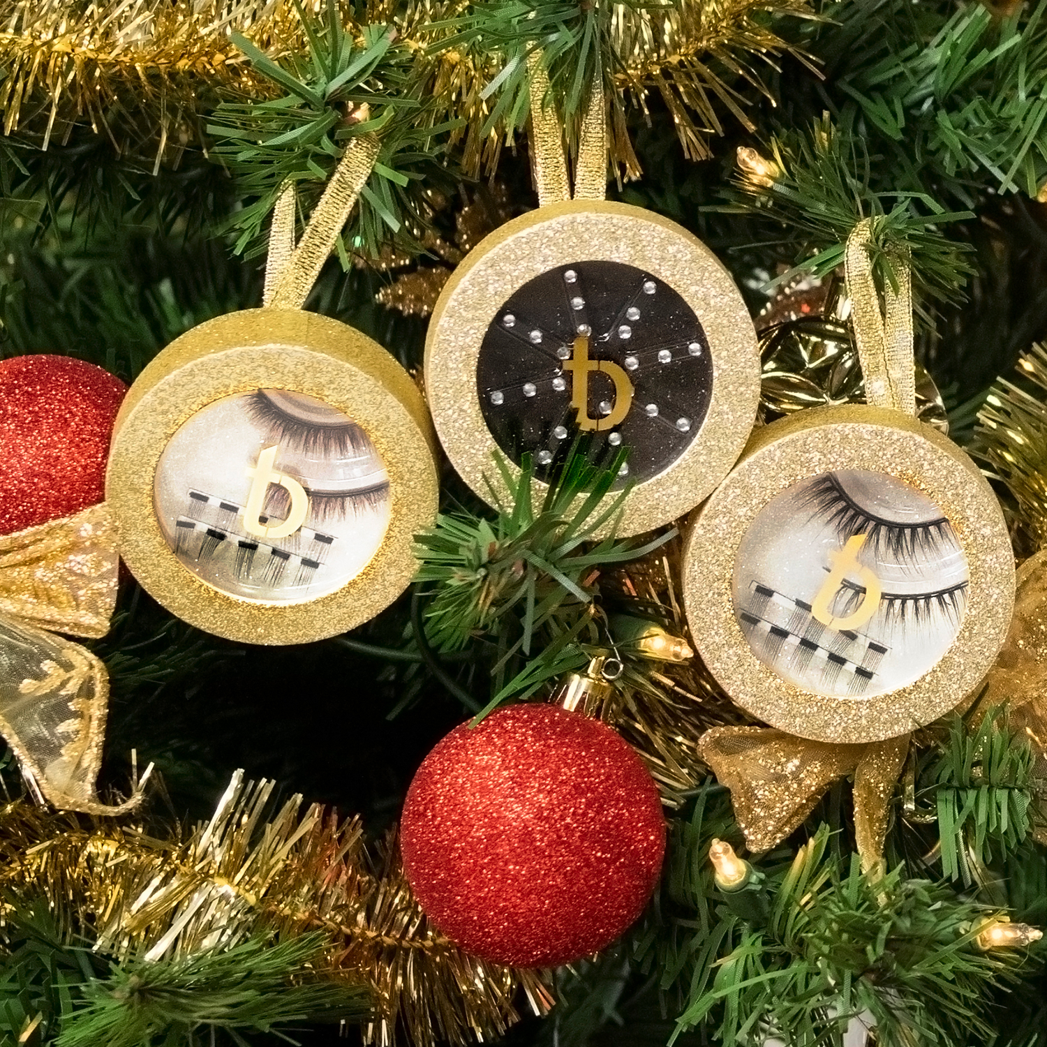 Holiday Luxe Bundle ornaments with lashes inside